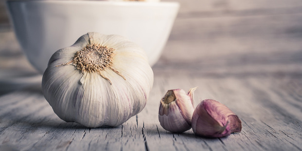 Garlic makes for a great flavour boost in any savoury meal. Photo / Getty