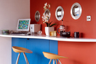 Red and brown walls inside your home are likely to provoke a strong opinion. Photo / Getty Images