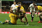 Billy Vunipola of England holds off Dane Haylett-Petty and Michael Hooper to score during their three test series last June. Photo / Getty