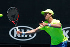 Marcus Daniell plays a forehand during the Australian Open. Photo / Getty Images