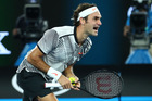 Roger Federer celebrates championship point at the Australian Open. Photo / Getty Images
