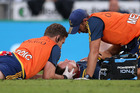 Ben Smith of the Highlanders receives medical attention after a clash for high ball with Damian McKenzie of the Chiefs. Photo/Getty Images
