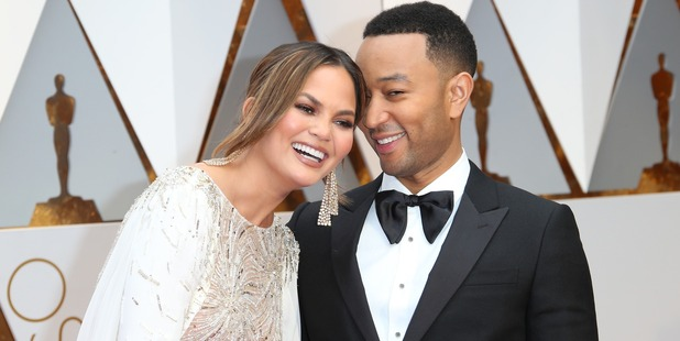 Model Chrissy Teigen (L) and musician and husband John Legend. Photo / Getty