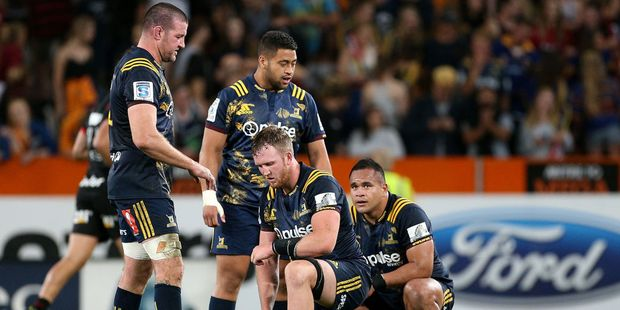 Highlanders players show their dejection after their loss to the Crusaders. Photo / Getty