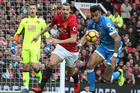 Zlatan Ibrahimovic of Manchester United in action with Tyrone Mings of AFC Bournemouth during the Premier League match. Photo/Getty Images