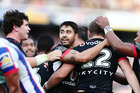 The Warriors celebrate Ryan Hoffman's match-winning try in the victory over the Knights. Photo / Getty
