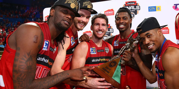 Jameel McKay, Angus Brandt, Damian Martin, Casey Prather and Bryce Cotton of the Wildcats pose with the trophy. Photo / Getty