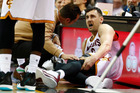 Andrew Bogut of the Cleveland Cavaliers reacts after getting hurt in the first half against Miami Heat. Photo/Getty Images