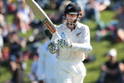 Kane Williamson acknowledges the crowd after bringing up his half-century. Photo / Getty