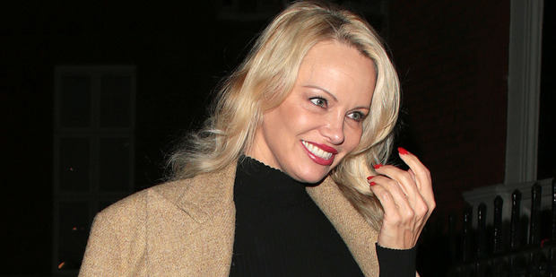Pamela Anderson seen arriving at the Ecuadorian Embassy to visit Julian Assange on March 9, 2017 in London. Photo / Getty