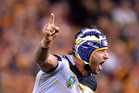 Johnathan Thurston of the Cowboys celebrates after kicking the winning field goal in golden point extra time against the Brisbane Broncos at Suncorp Stadium last night. Photo / Getty Images.