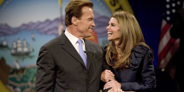 California Governor Arnold Schwarzenegger smiles at his wife Maria Shriver after being sworn into office for a second term as Governor on January 5, 2007. Photo / Getty
