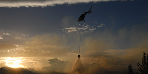 A helicopter came to help firefighters near Ormondville. Photo / Helen Upson