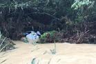 A police car was washed off a road in a flash flood near Kawakawa Bay. Photo/Angela Heenan