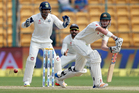 Australia's Matt Renshaw, right, plays a shot during the second day of their second test cricket match against India. Photo / AP