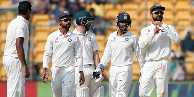 India's captain Virat Kohli, right, gestures to ask for a television review for the wicket of Australia's Matthew Wade. Photo / AP