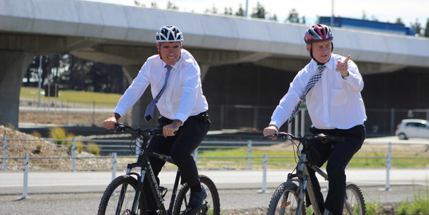 PEDAL POWER: Otaki MP Nathan Guy, left, and Prime Minister Bill English enjoy a bike ride on the Mackays to Peka Peka Expressway shared pathway at Waikanae.