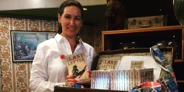 Historical fiction writer Kirsten McKenzie with her second book, The Last Letter. Photo / supplied.