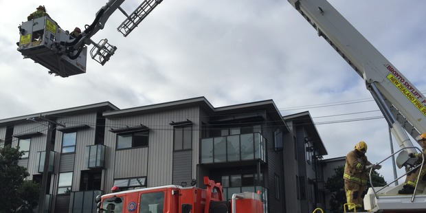 Loading Five fire engines and two aerial units attended the fire in a Mt Eden apartment complex. Photo / Michael Craig