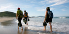Bream Head Coastal Walks guests on Ocean Beach, Whangarei Heads. Picture / Diane Stoppard
