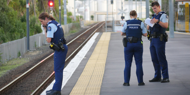 Police stand guard where a woman was trapped between a moving train and the station platform, Glenn Innes train station. Photo / Steven McNicholl
