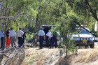 Police on the scene as the body of a missing boy they found in the Murray River is removed on Saturday, March 4. Photo / Hamish Blair