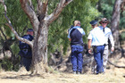 Police on the bank of the Murray River where they found the body of a missing boy on Saturday. Photo / News Corp / Hamish Blair