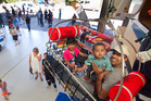Nithin Joseph took a ride in the winch simulator with Isaac Joseph, 1, and Aimee Joseph, 3. Photo/Ben Fraser