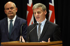 Bill English, right, announces the new super policy watched by Finance Minister Steven Joyce. Photo / Mark Mitchell