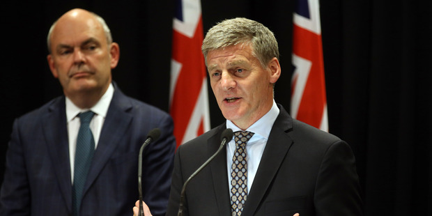 Loading Bill English, right, announces the new super policy watched by Finance Minister Steven Joyce. Photo / Mark Mitchell