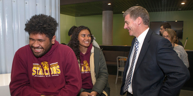 Loading Prime Minister Bill English surprises students Halaholo Mataele and Frederika Folaumoetu'i during his visit to Victoria University in Wellington. 09 March 2017. NZ Herald photo Mark Mitchell.