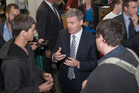 Prime Minister Bill English chats to students during his visit to Victoria University in Wellington. Photo / Mark Mitchell