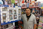Coin Save owner Tony Lin said he has used a wall of shame in his store for about a year to help deter theives. Photo/Ruth Keber