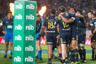 The Highlanders celebrate at the final whistle after beating the Blues. Photo / Brett Phibbs