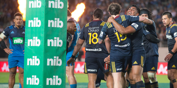 Loading The Highlanders celebrate at the final whistle after beating the Blues. Photo / Brett Phibbs