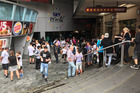 The I-max theatre in Downtown Auckland is evacuated after smoke was detected in the building. Picture / Eli Orzessek