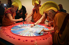 Ceremony at the Tauranga Art Gallery where the Sand Mandala is dissolved. Photo/Andrew Warner