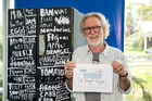 Artist Dick Frizzell shows off one of the Haier fridges he has decorated for charity. Photo / Supplied