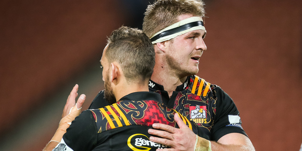 Chiefs first five Aaron Cruden (L) and Sam Cane (R) after the Chiefs victory in the Super Rugby match. Photo / Bruce Lim