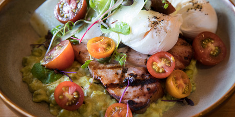 Char-grilled gammon with poached eggs and pea polenta at Giusto. Photo / Jason Oxenham
