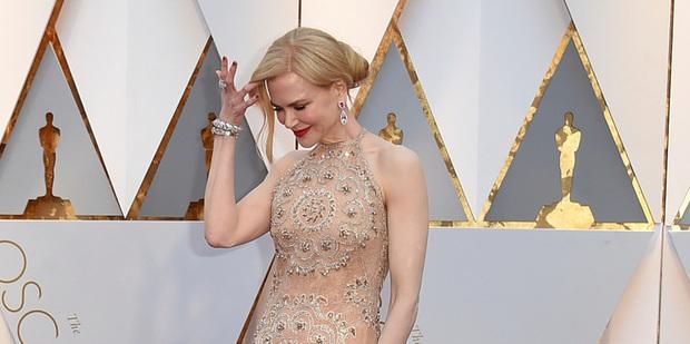 Nicole Kidman has explained her curious behaviour at the Oscars. Photo / AP