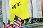 A banner for Snap Inc., the company behind Snapchat, hangs from the front of the New York Stock Exchange in New York. Photo / AP