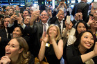 Friends and employees of Snap applaud at the opening bell of the New York Stock Exchange as the company celebrates its IPO. Picture / AP.