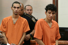 Two known MS-13 gang members, formerly of El Salvador, Miguel Alvarez-Flores (right)  and Diego Hernandez-Rivera appear in court. Photo/AP