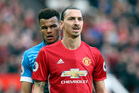 AFC Bournemouth's Tyrone Mings, left, and Manchester United's Zlatan Ibrahimovic during the English Premier League soccer match at Old Trafford. Photo / AP.