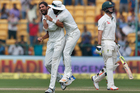 India's Ishant Sharma, left, celebrates with teammate Lokesh Rahul, center, the dismissal of Australia's Mitchell Marsh. Photo / AP