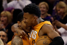 Phoenix Suns guard Tyler Ulis celebrates with Leandro Barbosa after hitting the game winning shot against the Boston Celtics in the fourth quarter. Photo / AP