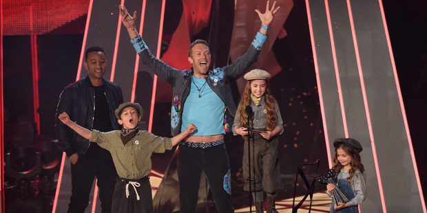 Chris Martin, of Coldplay reacts as child performers read an acceptance speech on behalf of Coldplay. Photo / AP