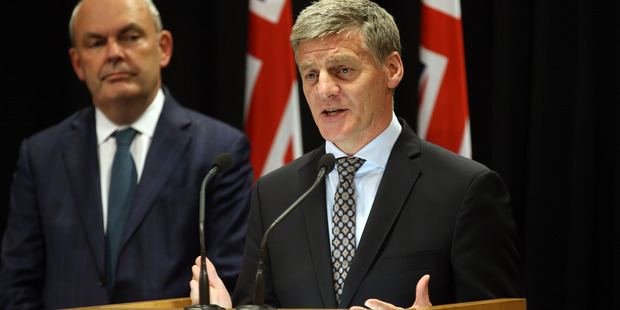 Prime Minister Bill English (right) and Finance Minister Steven Joyce announcing the  Government's superannuation changes on Monday. Photo / Mark Mitchell