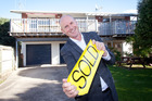 Mount Maunganui and Papamoa Ray White Realty Focus franchise owner Greg Purcell outside a property that has sold recently. Photo/file